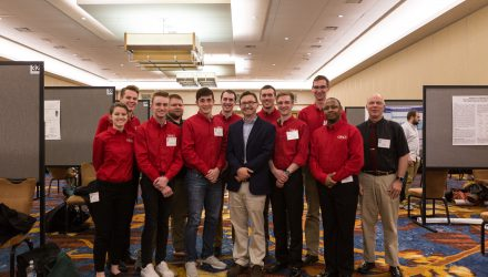 Chemistry professor, Dr. Chad Snyder, with students at the IAS conference